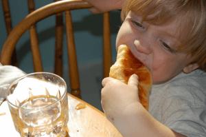boy eating brioche