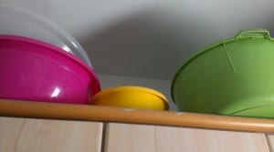 large mixing bowls on top of the cabinet