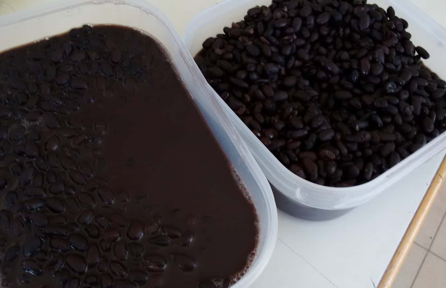 freshly cooked containers of black beans
